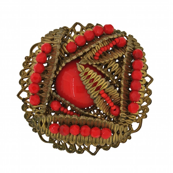 Gemma Redmond, Wigan: Gilt metal brooch with red glass beads, by Miriam Haskell, 1950s.