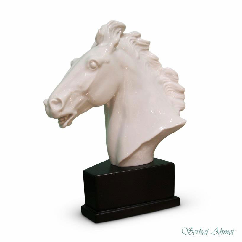 Meissen porcelain white-glazed bust of a stallion, mounted on an ebonised wooden plinth, by Erich Oehme, circa 1949. £600