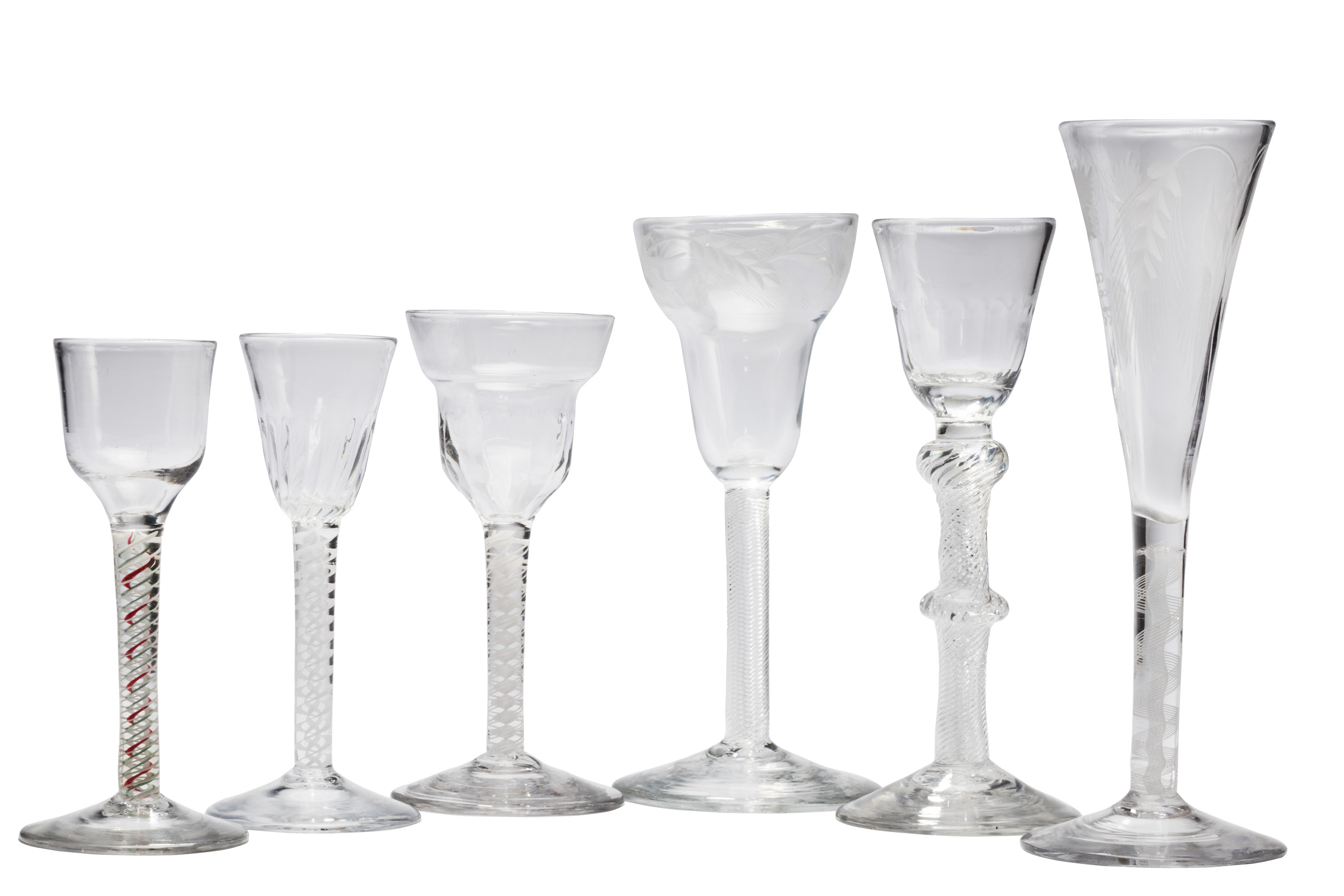 Antiques News - Antique Fair - Filemans Antiques - Selection of 18th century spiral stemmed wine glasses, £360-£3,600.