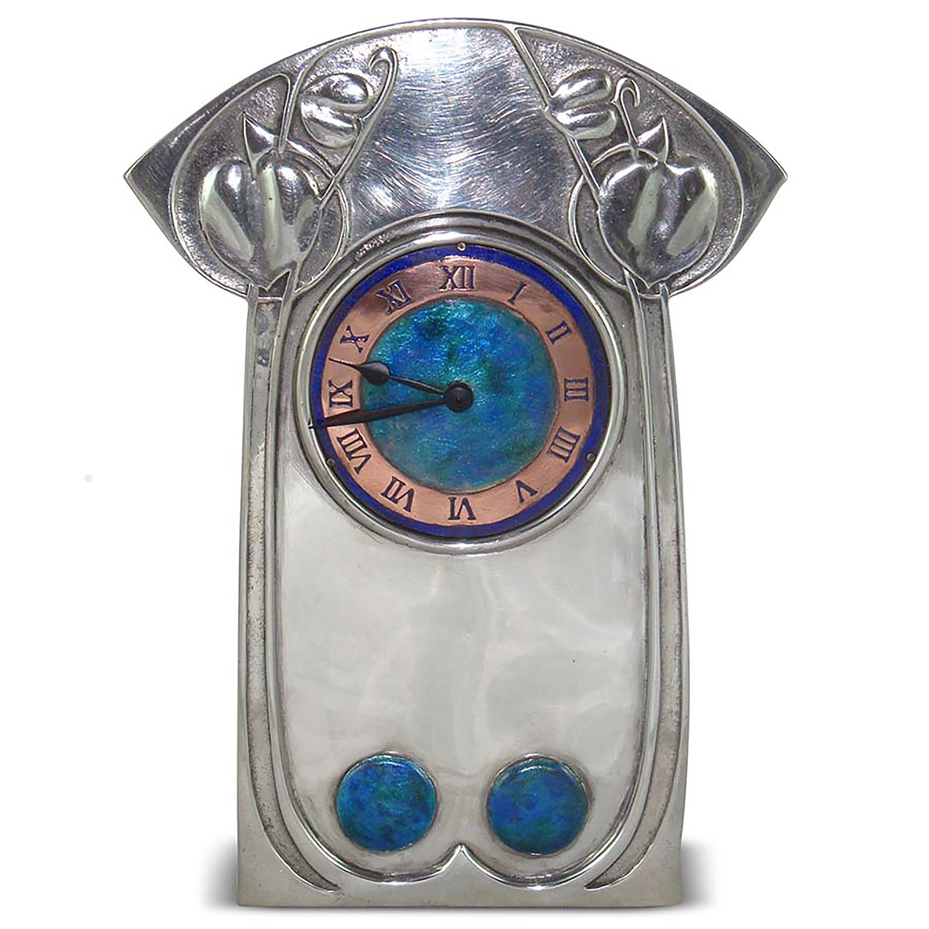 Antiques News - Antique Fair - Morgan Strickland Decorative Arts - Tudric pewter and enamel clock by Archibald Knox for Liberty & Co, c1902, £5,950.