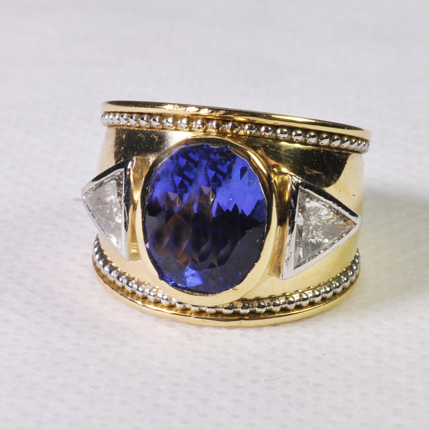 Antiques News - Antique Fair - Plaza - Theo Fennell tanzanite and diamond ring, £4,500.
