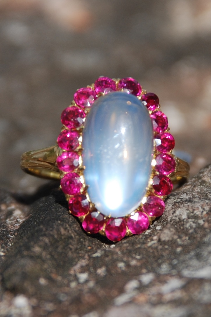 18ct Gold Ruby & Moonstone Cluster Ring, c.1930, priced at £3000 from Thomas Glover.